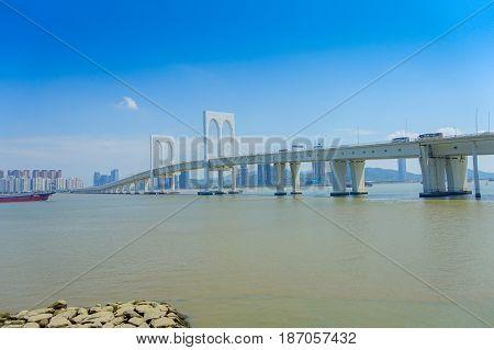 MACAU, CHINA- MAY 11, 2017: Sai Van bridge and business building.