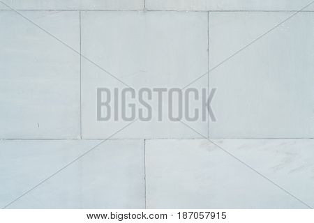 Large blocks of marble white wall without an explicit pattern