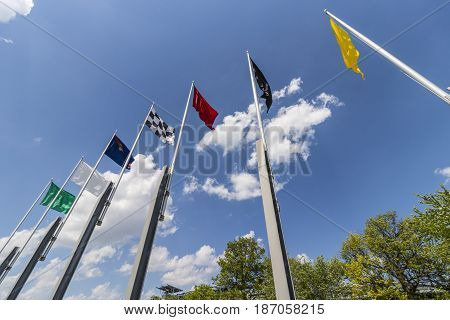 Indianapolis - Circa May 2017: The seven racing flags at Indianapolis Motor Speedway. IMS Prepares for the 101st Running of the Indy 500 V