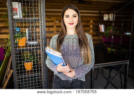 Freelance Developer Or Designer With Notebooks And Papers Standing At Office Room