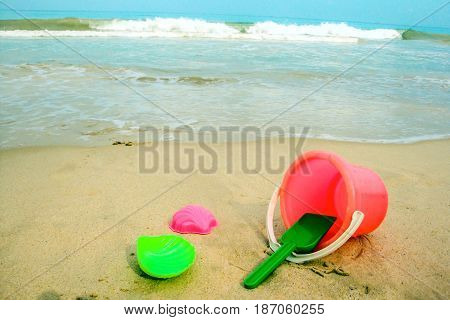 Children's pail and colored molds on the beach in the sand. Studio Photo