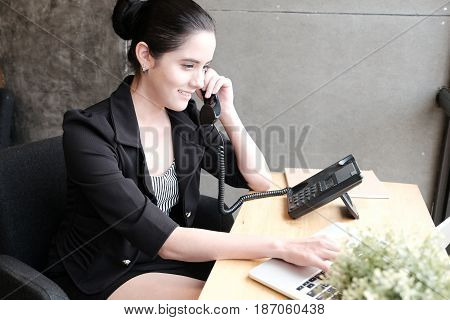 Smilling Young Businesswoman On Phone