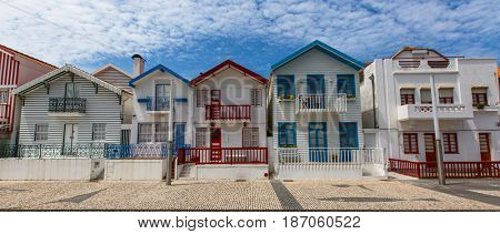 Beach houses with striped colored painting in Costa Nova, Portugal.