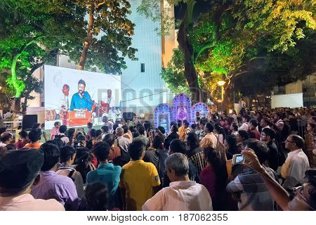 KOLKATA WEST BENGAL INDIA - 9TH MAY 2017 : Male singer performing and seen in a giant screen amongst audience at Rabindra Jayanti celebration (birthday of Late Nobel winner Poet Rabindranath Tagore).
