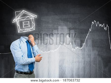 Businessman with model of house instead of his head