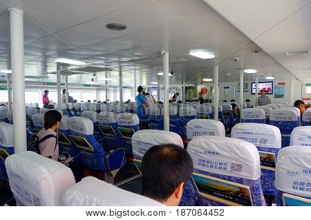 SHENZHEN, CHINA- MAY 11, 2017: An unidentified people waiting inside of the TurboJet Tai Shan that provides services between Hong Kong, Macau, Shenzhen and around the Pearl River Delta in southern China.