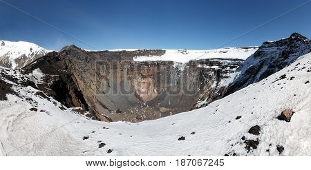 Panorama volcano landscape of Kamchatka Peninsula: large summit crater of active Tolbachik Volcano with steep sides and glaciers. Russian Far East Kamchatka Region Klyuchevskaya Group of Volcanoes.