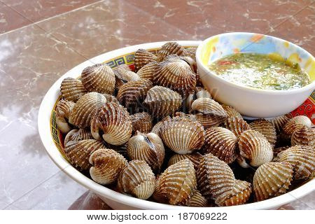 Steamed blanched clams with dipping sauce seafood.