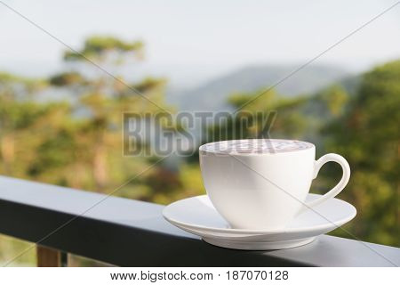 Cup Of Hot Cappuccino Coffee On Nature Background