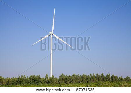 A Wind turbines farm. Alternative energy sourcewind turbine sunset background ecosystem vintage