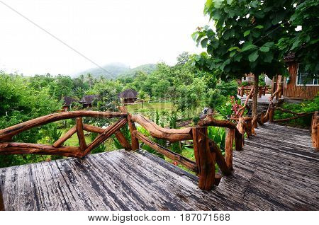 balcony wooden villa resort exterior The resort gardens trees nature Mountain mist