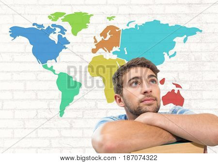 Digital composite of Businessman looking up with Colorful Map with wall background