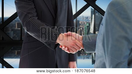 Digital composite of Midsection of business people shaking hands