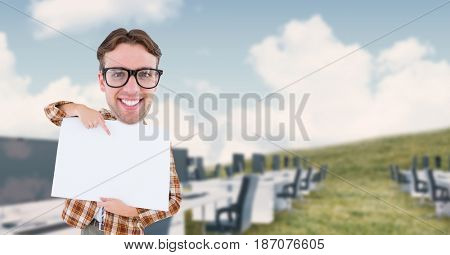 Digital composite of Digital composite image of nerd businessman pointing at blank placard