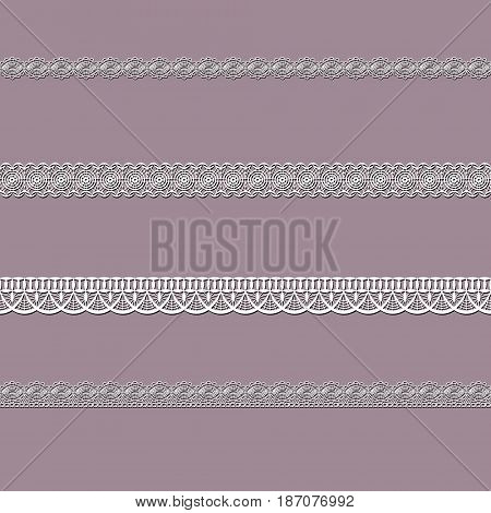set of white lace ribbons on a pink background