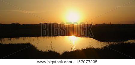 Evening landscape, pond, steppe, sunset, Countryside landscape under scenic colorful sky