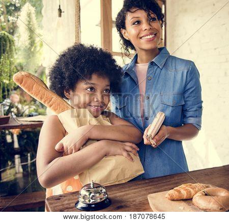Customer buying bread at bake shop