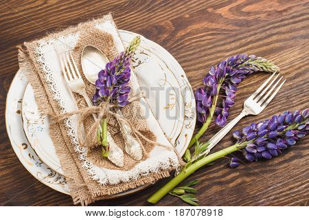 Tableware And Silverware With Puffy Violet Lupins