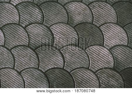 Street paving fish scale pattern as abstract background