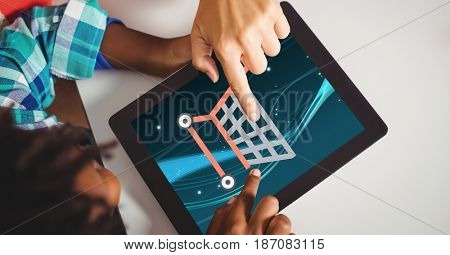 Digital composite of Hands touching shopping cart icons on tablet computer