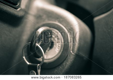 Close-up photo of a car key in the ignition
