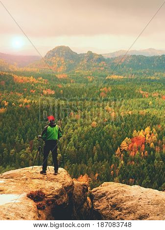 Amateur Photographer Prepare Camera To Takes Impressive Photos Of  Misty Fall Mountains