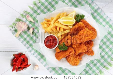 Nuggets With Tomato Sauce,french Fries, Lemon
