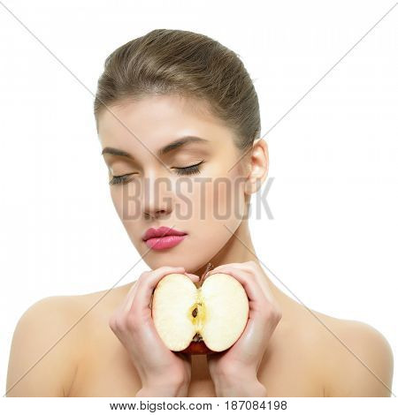 Young attractive girl posing at studio with apple. Beautiful female face with healthy skin and close eyes. Health care, cosmetology, antiaging, beauty treatment, diet, feminity, spa concept.