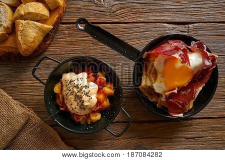 Tapas from spain broken eggs and bravas potatoes