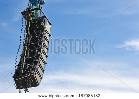 Stadium speakers rack over a blue sky. Live music background. Horizontal