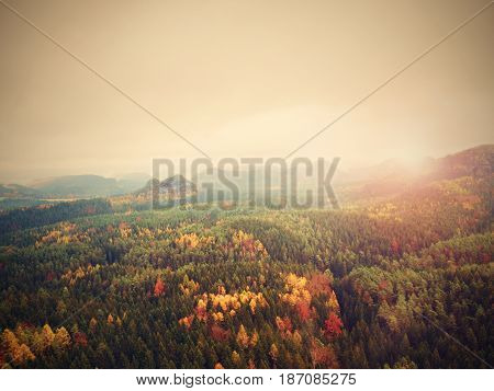 Autumnal Sunrise In A Beautiful Mountain. Sandstone Peaks Increased From Mist