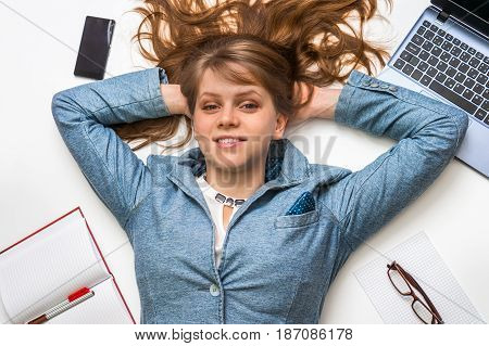 Smiling Woman Lying On Back With Laptop On White