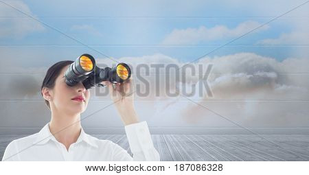 Digital composite of Businesswoman looking through binoculars