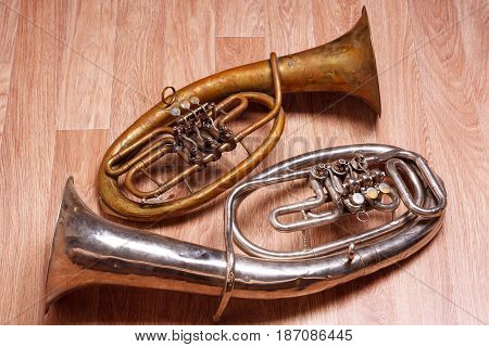 Two Old Rusty Alto Saxhorn On Wooden Background