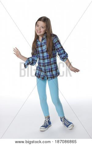 Caucasian girl with arms outstretched
