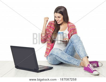 Woman Using Laptop Success on Notebook Happy Girl Sitting on Floor with Computer over White Background