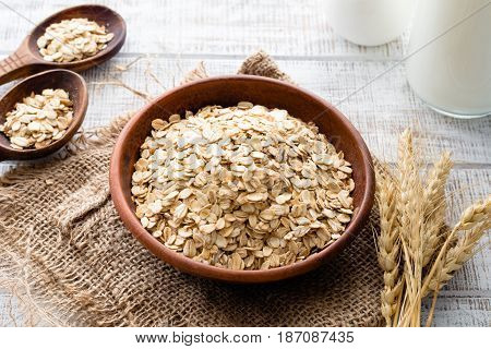 Oats, rolled oats or oat flakes in bowl. Healthy eating, healthy lifestyle concept