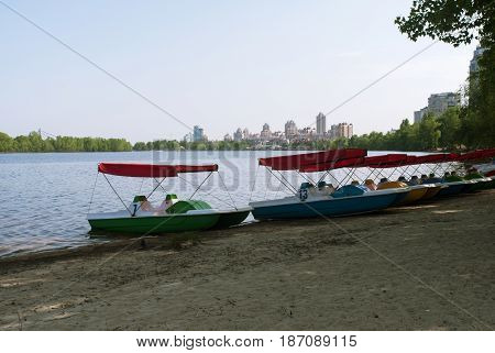 Pedal catamarans on the shore of Obolonskaya Embankment in Kiev Ukraine