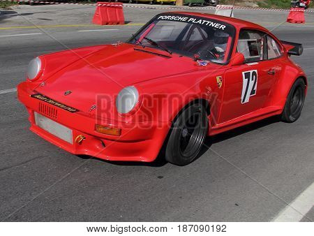 Favale di Malvaro Italy - July 19 2015 Racing race uphill Favale-Castello: A Porsche Carrera Rs of the 2007 Favale scuderia engaged in the race.