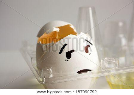 An Egg With A Face. Concept Of Headache. Hangover