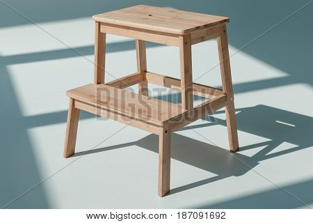Simple Wooden Flower Stand At Empty Room With Daylight