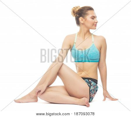 Sporty Beautiful Young Female Doing Yoga Sitting Left Twist / Ardha Matsyendrasana Left / Spinal Twi