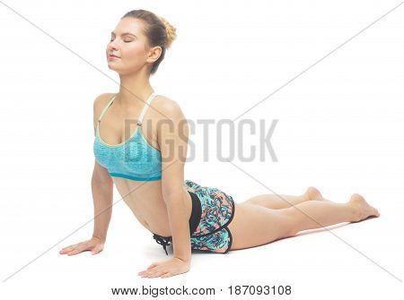 Sporty beautiful young female doing yoga Upward facing dog left / Urdhva Mukha Svanasana isolated on white background