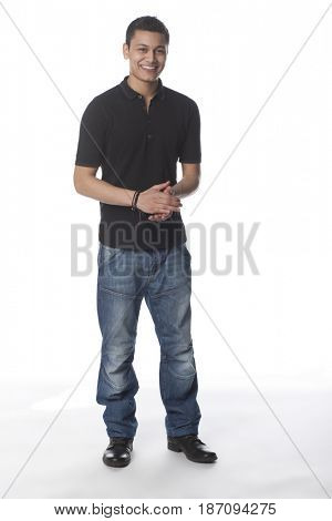 Smiling mixed race man with hands clasped