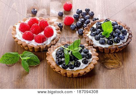 Tarts With Fresh Raspberries And Blueberries