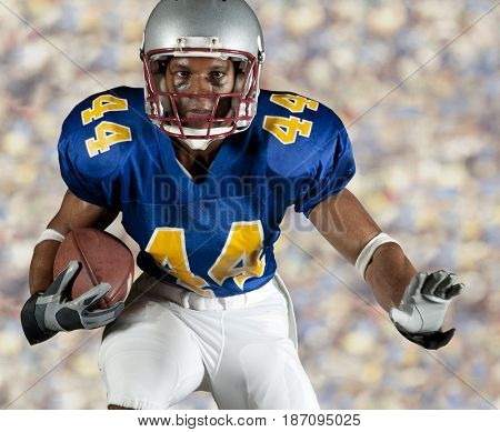 Black football player running with ball