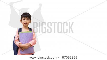 Digital composite of Digital composite image of girl holding books with graduate shadow in back