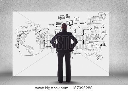 Digital composite of Rear view of business person looking at icons and text on bill board