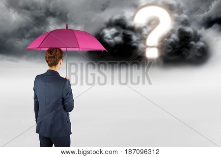 Digital composite of Digital composite image of businesswoman with umbrella looking at question mark in sky