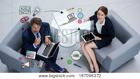 Digital composite of Business people with technologies looking at graphics